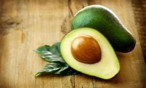 preview-full-avocado-on-a-wooden-table