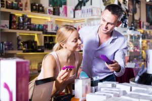 couple looking at toys in sex shop