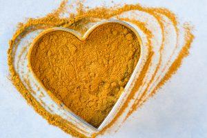 turmeric powder in heart bowl