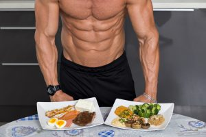 fit guy with plates of healthy food also takes Progentra pills