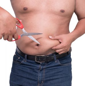 man holding scissors against belly fat