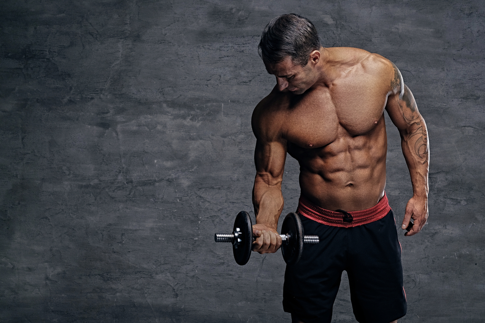 ripped guy who takes Progentra lifting weights