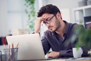 man tired and stressed at work started searching for Progentra online