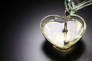 pouring olive oil in heart bowl