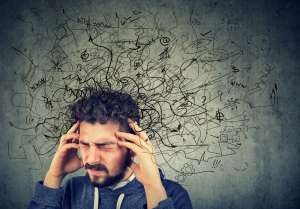 man stressed beyond his wits