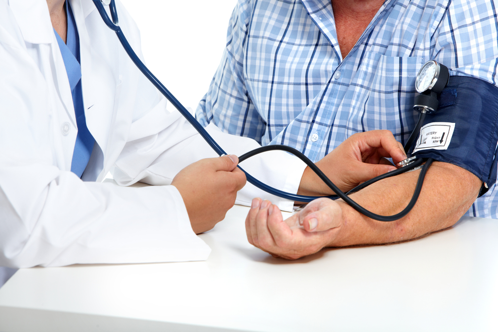 old man checked for blood pressure